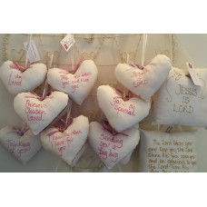 Various Hanging Heart Pillows With Sentiments