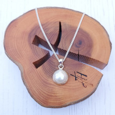 Round Pearl And Silver Pendant